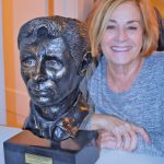 Barbara Fischler poses with the bust that she sculpted of writer Jack Kerouac